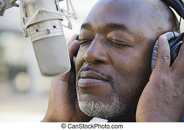 Man in Front of Microphone