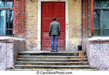 Man in Front of the House