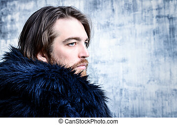 man in fur coat - Fashion shot of a stylish brutal bearded...