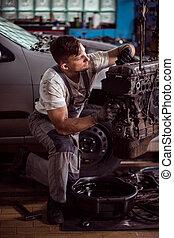 Man in garage servicing car