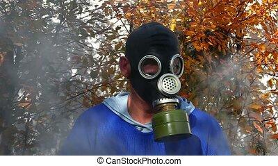 Man in gas mask in fog
