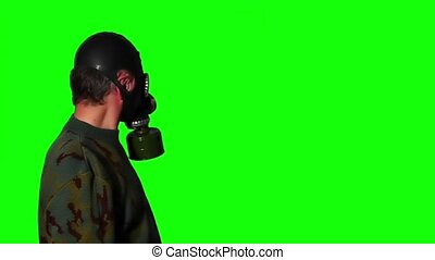 Man in gas mask on a green screen 2