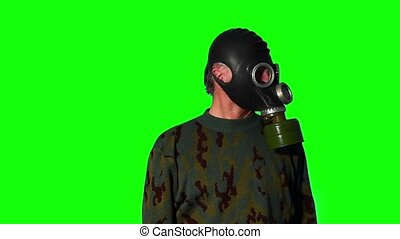 Man in gas mask on a green screen