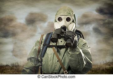 Man in gas mask with binocular on war