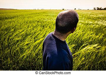 Man in green field