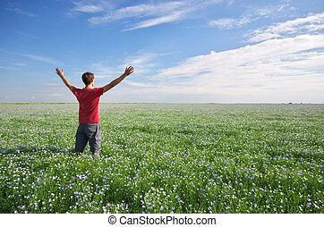 Man in green meadow.