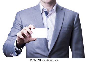 Man in grey suit holding a business card.