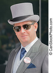 Man in grey top hat and sunglasses - A man in grey morning ...