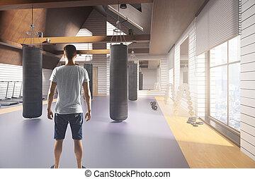 Man in gym interior
