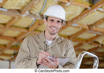 man in hard hat looking at camera