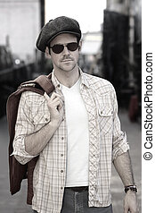 Man in hat and shades outdoors - Stylized fashion portrait...