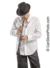 man in hat playing clarinet - mature man in hat playing...