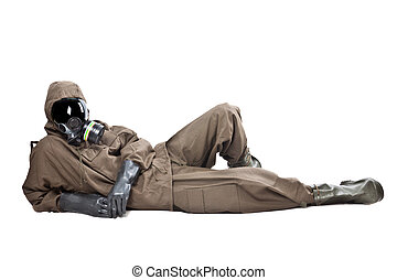 Man in Hazard Suit layng on the ground - A man wearing an...