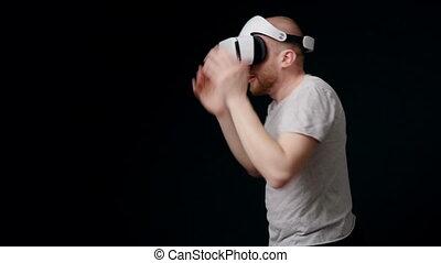 Man in head-mounted display boxing - Man boxer in virtual...
