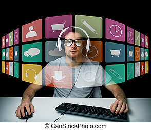 man in headset with computer and icons on screen