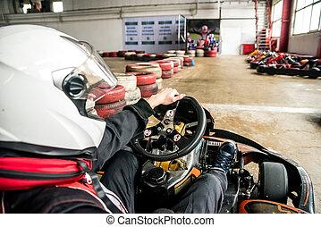 Man in helmet drives go-kart