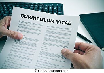 curriculum vitae - man in his office checking a curriculum...