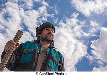 Man in his turban under a blue cloudy sky