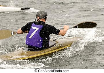 Man in kayak race - Man is racing in his kayak