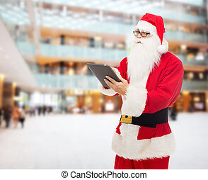 man, in, kostuum, van, santa claus, met, tablet pc