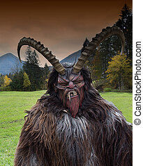 Man in Krampus costume - Man wearing traditional Krampus...