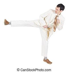 Man in light suit beats a foot