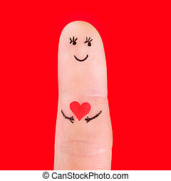 man in love concept - a man with red heart, painted at finger isolated on red background
