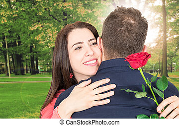 man in love makes a surprise with a red rose