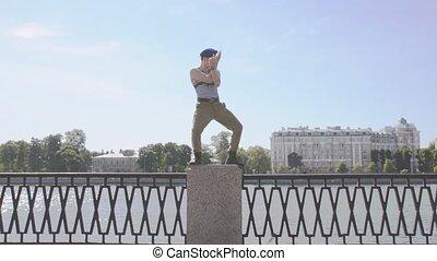 Man in marine uniform, sunglasses show weird gesture,...