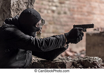 handgun - man in mask with handgun