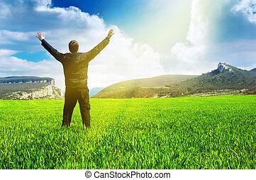 Man in meadow green meadow