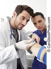 man in medical glove with syringe