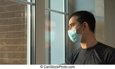 Man in medical mask stay at home. Self isolation.