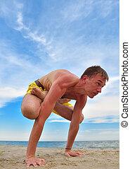 man in meditation near the ocean