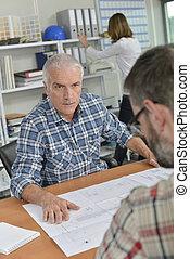 Man in meeting, looking angry