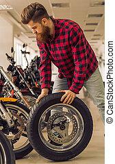 Man in motorbike salon
