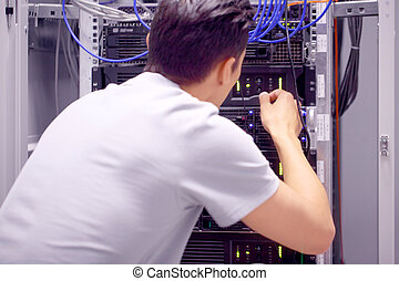 Man in network server room
