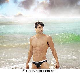 Man in ocean - Beautiful male model in sexy swimwear in the...