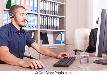 Man in office wearing a headset