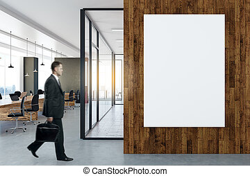 Man in office with poster