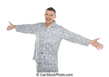Man in pajamas. Happy young man in pajamas with outstretched...