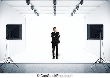 Man in photo studio - Handsome young man in suit standing in...