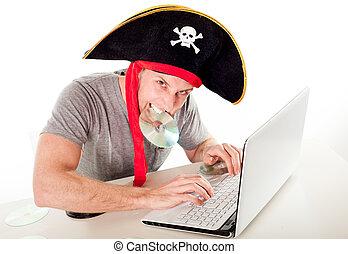 man in pirate hat downloading music on a laptop - man...