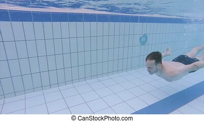 Man in pool at aquapark