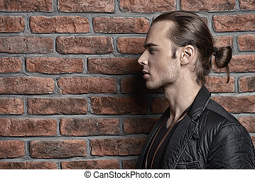 man in profile - Fashion shot. Handsome sexual young man...
