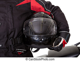 Man in protective gear with his motorbike