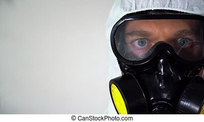 Man in protective suit and mask. - Male doctor in protective...