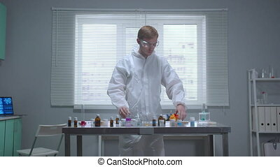 Man in protective workwear smell things on the table - Man ...