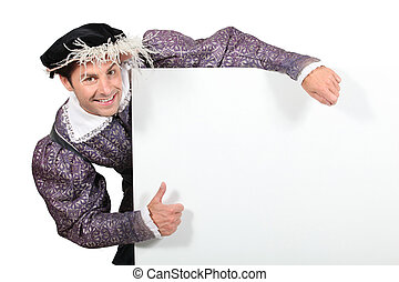 Man in purple fancy dress costume holding blank message board
