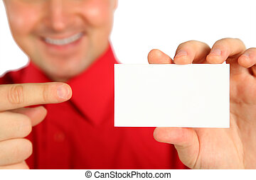 Man in red shirt with card in hand